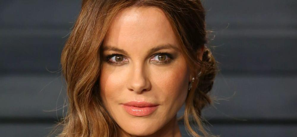 Kate Beckinsale Gets Flexible On A Bed To Show A Good Heart
