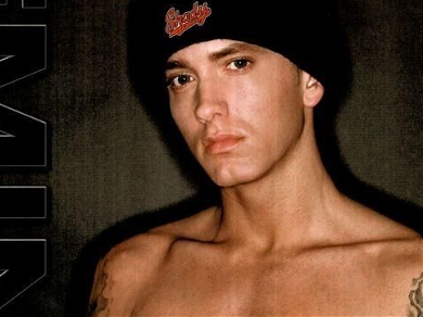 Eminem's 'Dolly Parton Challenge' Post Includes Nude Photo Labeled 'Grindr'