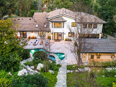 Miley Cyrus Buys House In The Kardashian's Neighborhood With It's Own Movie Theater!!