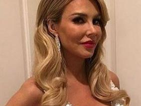 'RHOBH' Brandi Glanville Begs Andy Cohen For Her Job Back, Her Sons Join In Too