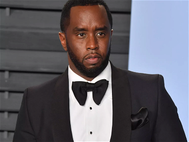 Diddy Photographed With Unidentified, Bikini-Clad Woman In Shirtless Miami Beach Snaps
