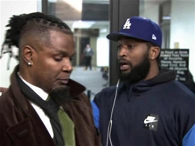 R. Kelly Fan Heckles Singer's Publicist During Press Conference After Arrest