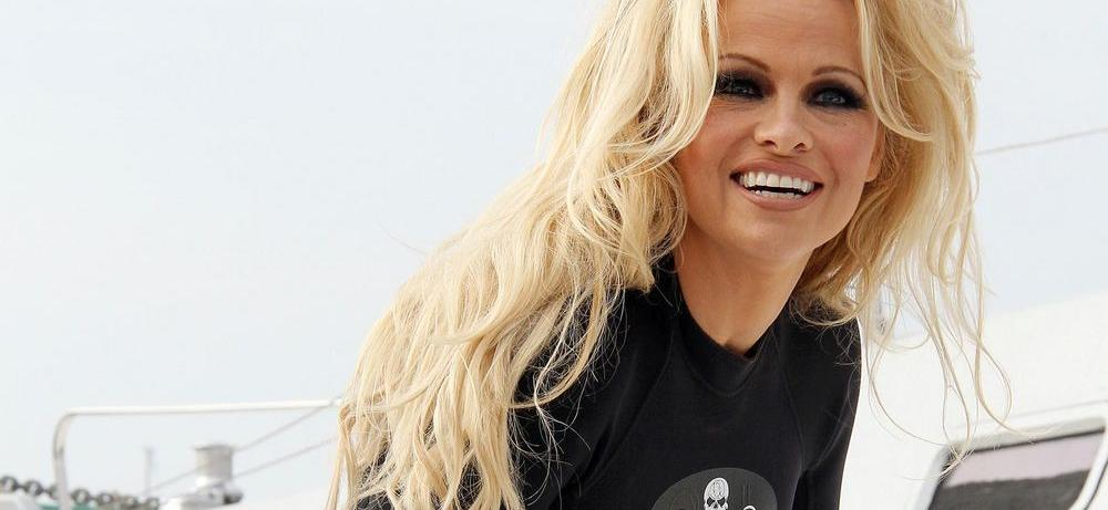 Pamela Anderson Folds Leg In Frontless Dress To Explore 'Architecture'