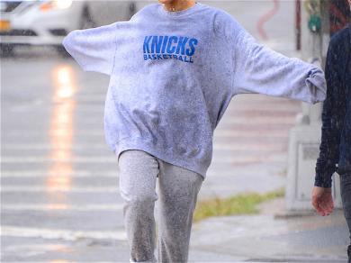 Ariana Grande Plays in the Rain