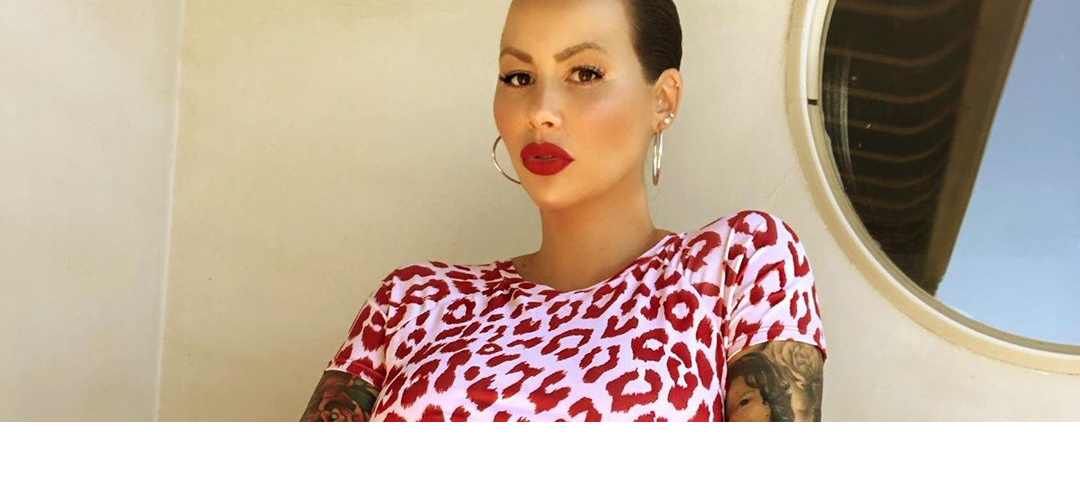 Amber Rose Poses in Risqué Shot While 8-Months Pregnant