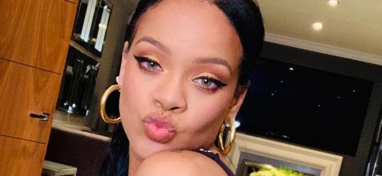 Rihanna Checks Her Backside Out In Cherry Bikini