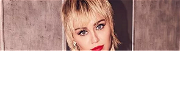 Miley Cyrus Rocks Out While Braless In Skintight Animal Print Bodysuit!