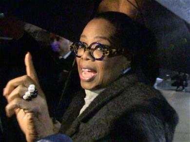 Oprah Winfrey Poses for Pics and Answers Questions in Rain-Soaked Street Session